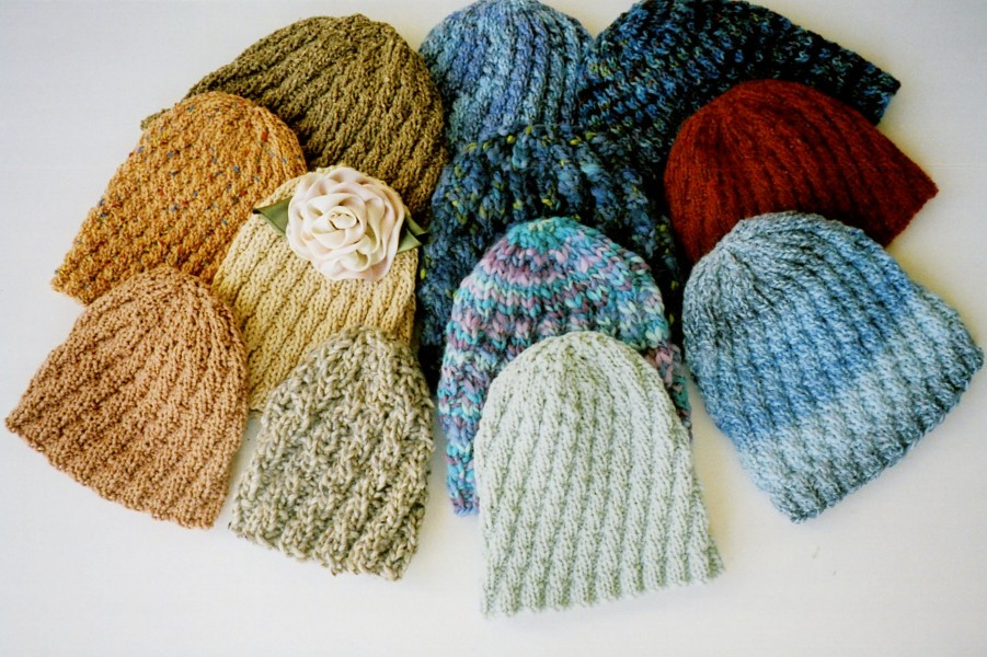 Ann Norling 54 Spiral Rib Hat in 8 different gauges of yarn for child to large adult.