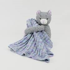 DMC Hug This Kitten Blanket. Simple Cables Baby Blanket pattern and yarn with stuffed kitten.
