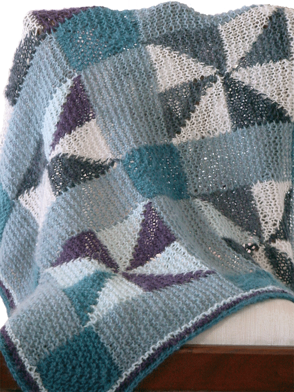 Fiber Dreams Pinwheel Blanket. Uses #4/Worsted weight yarn or thicker.